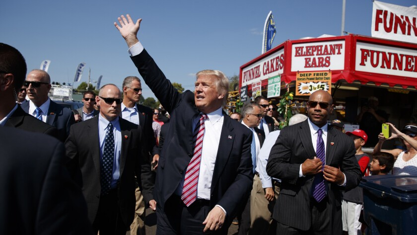 Donald Trump waves during a visit to the Canfield Fair in Canfield, Ohio, on Monday.