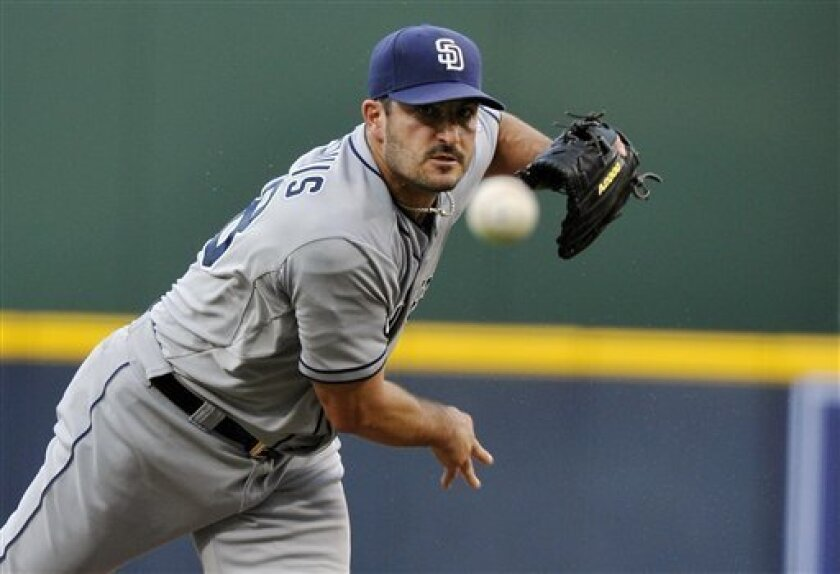 San Diego Padres pitcher Jason Marquis works in the first inning of a baseball game against the San Diego Padres, Thursday, Aug. 16, 2012, in Atlanta. (AP Photo/Rainier Ehrhardt)