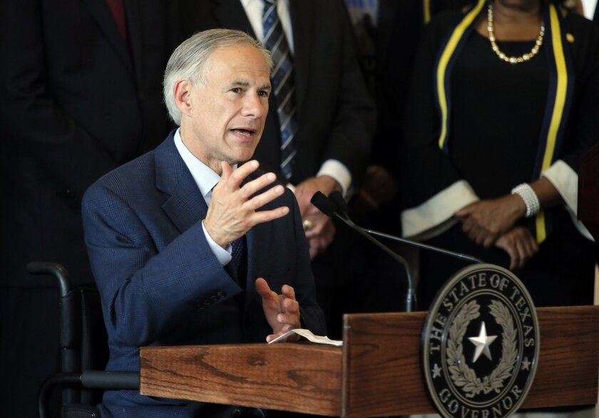 FILE - In this Friday, July 8, 2016 file photo, Texas Gov. Greg Abbott, right, responds to questions about the police shootings during a news conference at City Hall in Dallas. Spokesman Matt Hirsch said Sunday that Abbott was in Jackson Hole, Wyo., Thursday when he was scalded in an accident invol