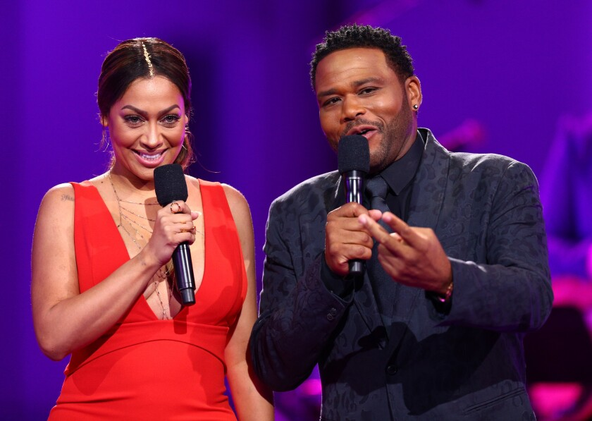 """Hosts La La Anthony and Anthony Anderson speak onstage during the VH1 """"Dear Mama"""" taping on May 6."""