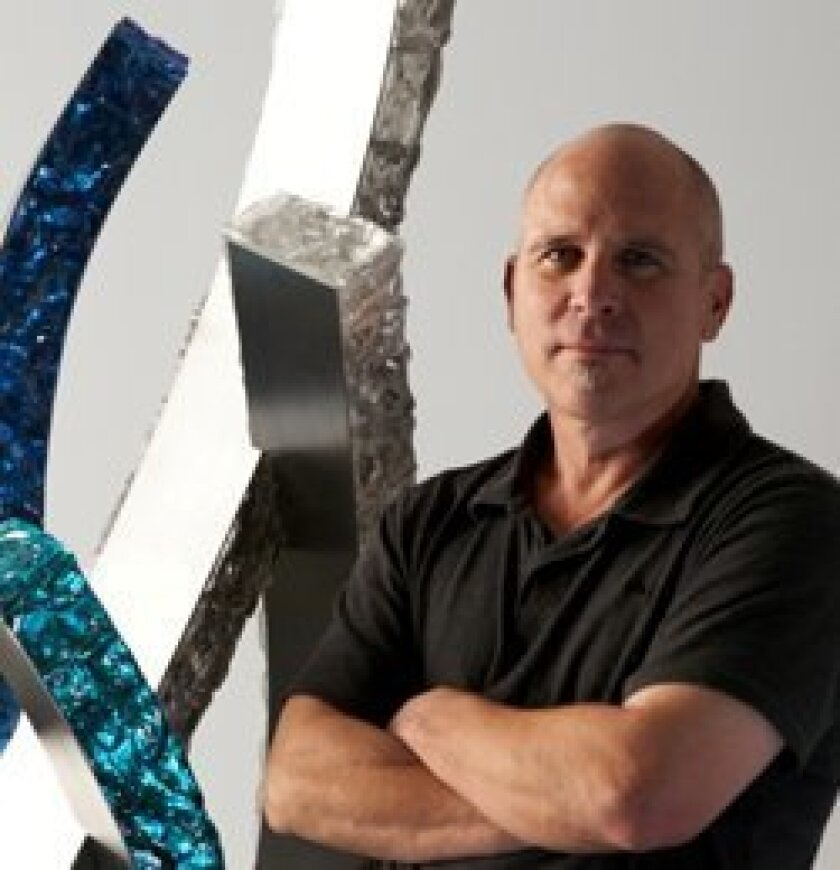 "Del Mar artist Richard ""Rick"" Frederick with his award-winning sculpture ""Splash."""
