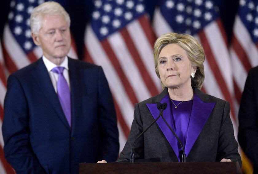 Hillary Clinton delivers her concession speech next to her husband former President Bill Clinton at the New Yorker Hotel's Grand Ballroom in New York.