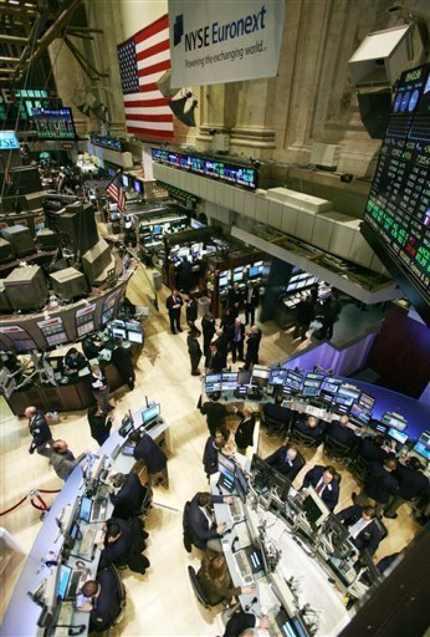 FILE - In this file photo taken March 8, 2010, the trading floor of the New York Stock Exchange, is shown. The absence of big moves Monday, June 7, 2010, comes after major indexes plummeted more than 3 percent Friday. Investors sold stocks following the Labor Department's monthly employment report that showed a lack of hiring by private employers in May.(AP Photo/Mark Lennihan, file)