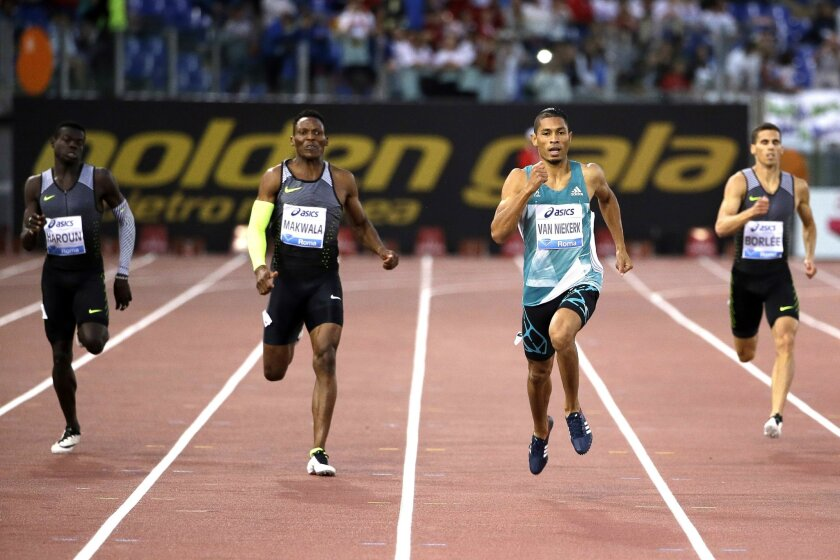 South Africa's Wayde van Niekerk, second from right, runs on his way to win the men's 400m event at the Golden Gala IAAF athletic meeting, in Rome's Olympic stadium, Thursday, June 2, 2016. (AP Photo/Gregorio Borgia)