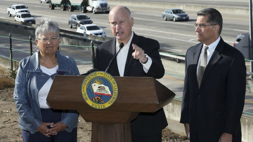 Calif., Governor Jerry Brown, center, blasts a Trump administration plan to freeze vehicle emissions standards at a press conference in Sacramento. Brown was joined by California Air Resources Board Chairwoman Mary Nichols, and Atty. Gen. Xavier Becerra.