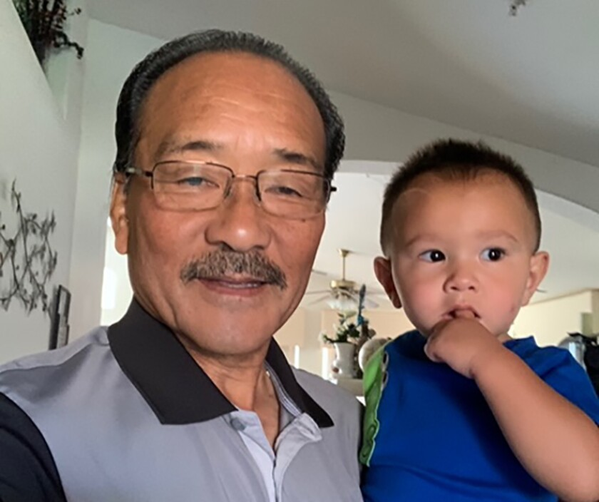 A San Diego advocate for low income workers and racial equality, Robert Ito poses with his grandson.