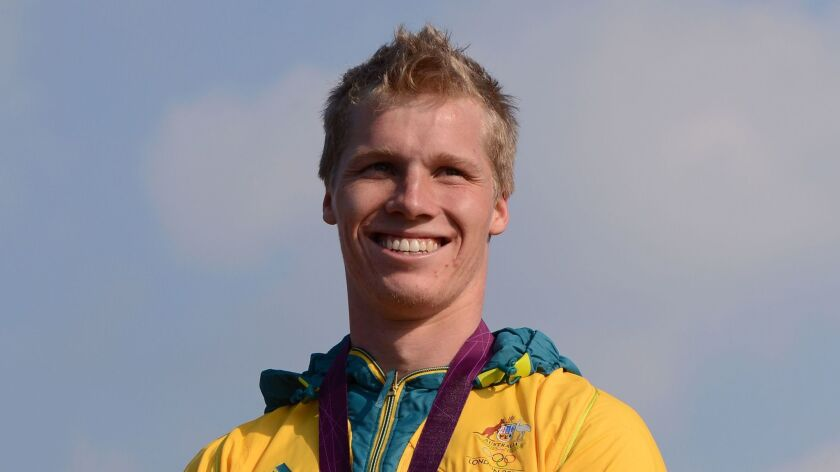 This file photo taken on August 10, 2012 shows Australia's Sam Willoughby standing on the podium with his silver medal after the BMX cycling men's final event at the London 2012 Olympic Games.
