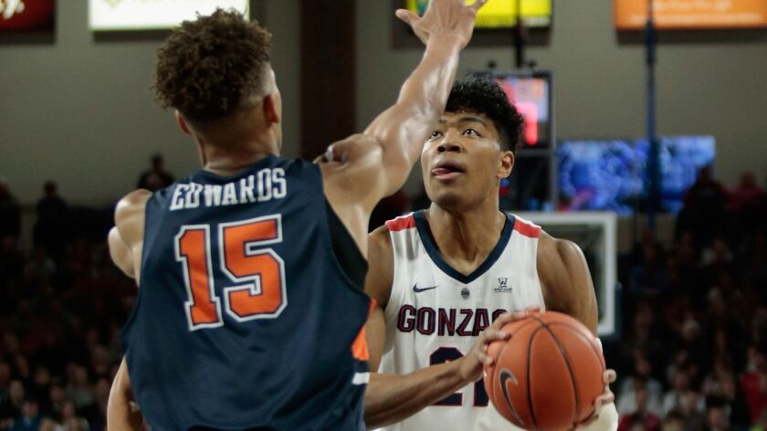 Gonzaga's Rui Hachimura (21) looks to shoot against Pepperdine's Kessler Edwards (15) in the first half on Thursday.