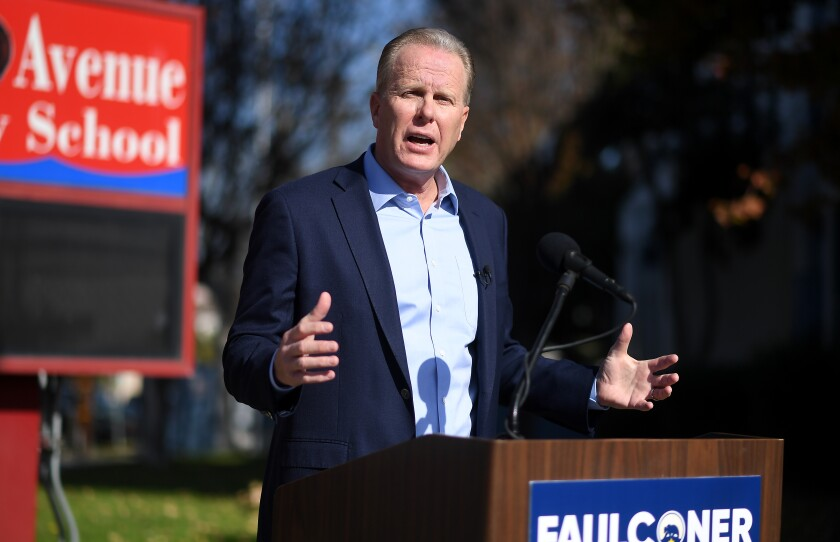 Kevin Faulconer speaks at a news conference in front of a school