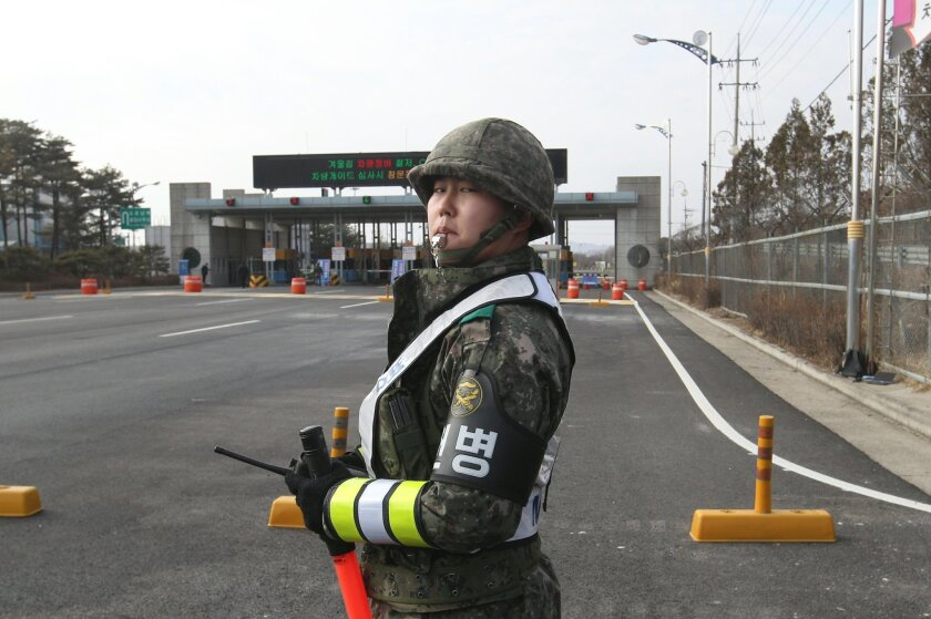A South Korea Army soldier stands guard at the customs, immigration and quarantine office near the border village of Panmunjom, in Paju, South Korea, Thursday, Feb. 11, 2016. South Korean workers on Thursday began shutting down a jointly run industrial park in North Korea, a move that will end, at