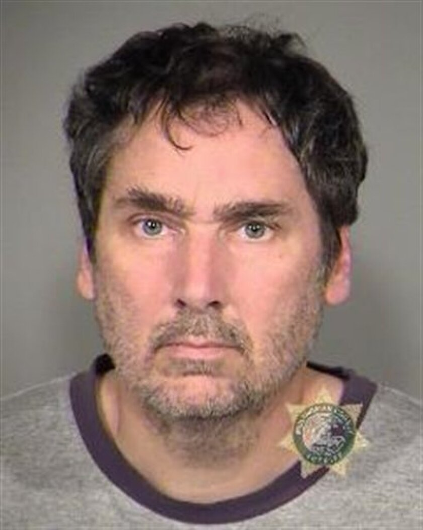 This booking photo from the Multnomah County Sheriff's Office shows Darryl James Swanson, 45, at the Multnomah County Jail in Portland, Ore., on Friday, July 1, 2011. Swanson was detained to undergo a mental health evaluation after appearing in federal court Tuesday to face charges that he threatened to kill President Barack Obama and the president's family. (AP Photo/Multnomah County Sheriff's Office)