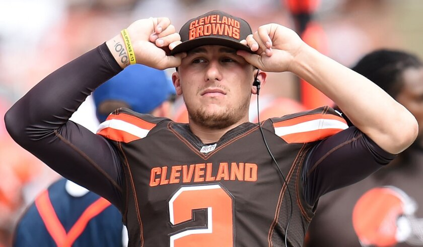 Cleveland's Johnny Manziel looks on from the sidelines against Oakland on Sunday.