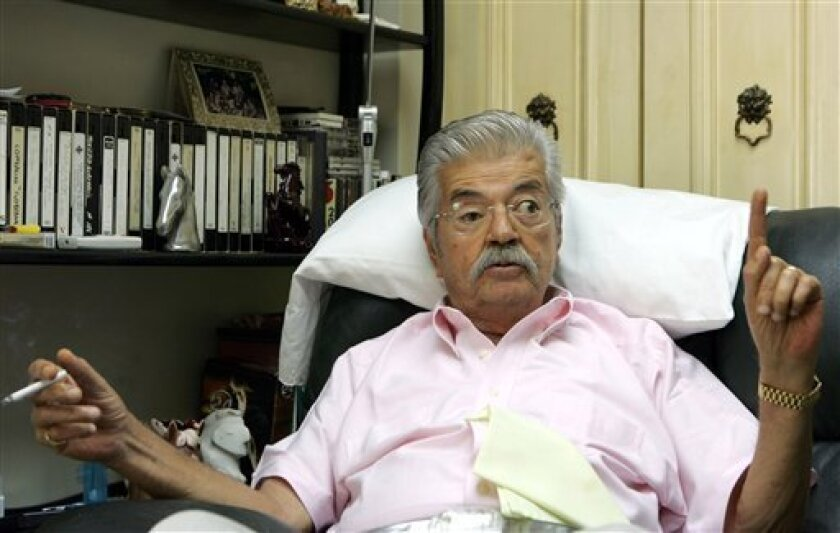 Former Ecuador's President Leon Febres Cordero speaks during an interview with The Associated Press in Guayaquil, Ecuador, in this Aug. 10, 2006, file photo. Febres Cordero has died at age of 77 of complications from pulmonary emphysema, a close friend of former Ecuador's President said. (AP Photo/Dolores Ochoa)