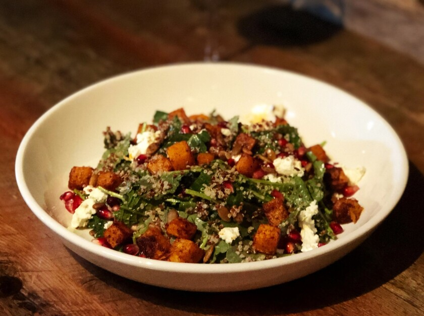 Spiced butternut and baby kale salad with roasted pepitas, quinoa, pomegranate seeds and goat cheese, one of new executive chef Michael Welch's fall menu, rolling out in early November, at Union Kitchen & Tap in Encinitas.