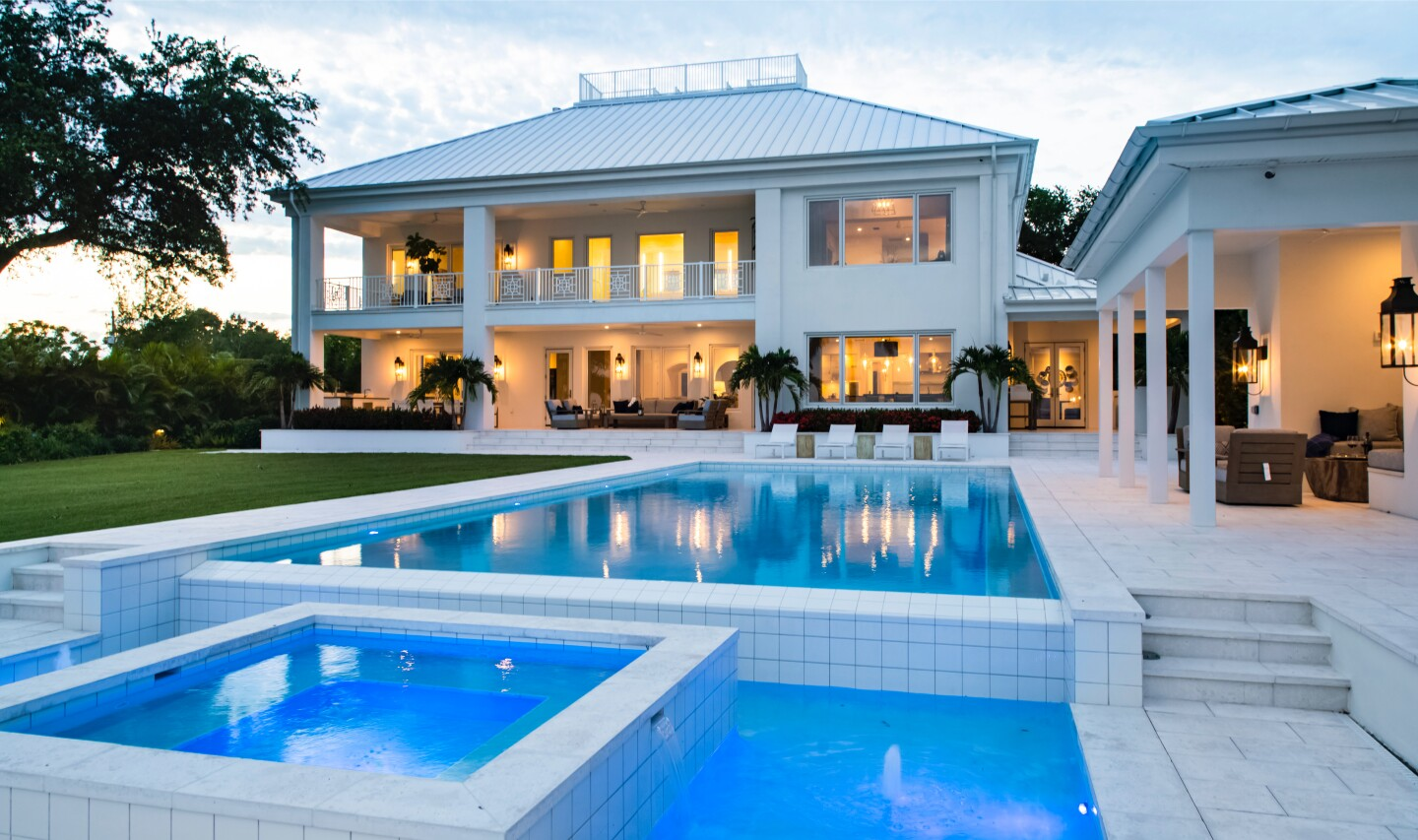 The nearly 9,000-square-foot home expands to a backyard with a pool and boat dock.