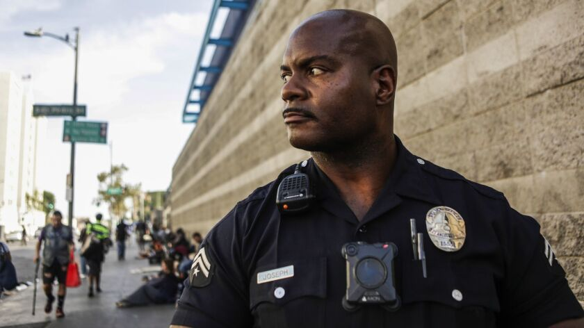 LOS ANGELES, CA -- WEDNESDAY, SEPTEMBER 26, 2018-- Officer Deon Joseph smiles as he waves hello to m