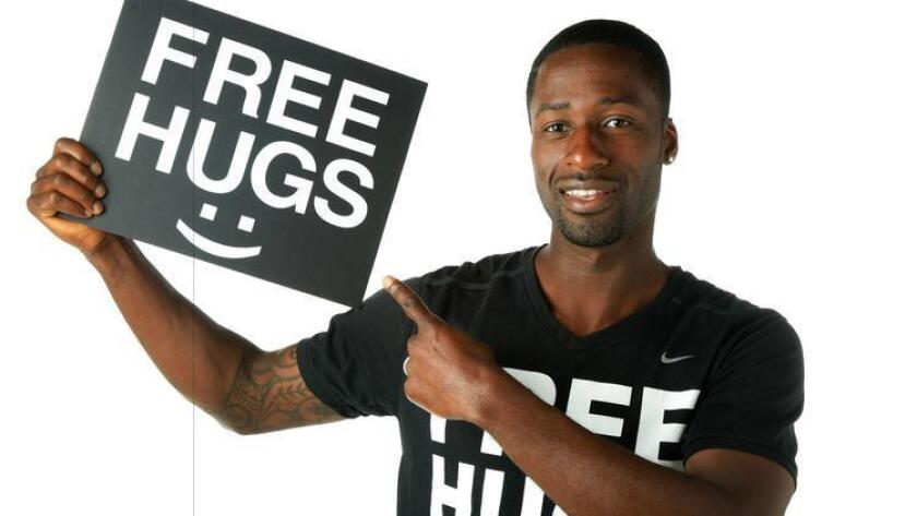 Lakeside resident Ken Nwadike, creator of the Free Hugs Project, brought his movement closer to home in El Cajon. (Howard Lipin/San Diego Union-Tribune)