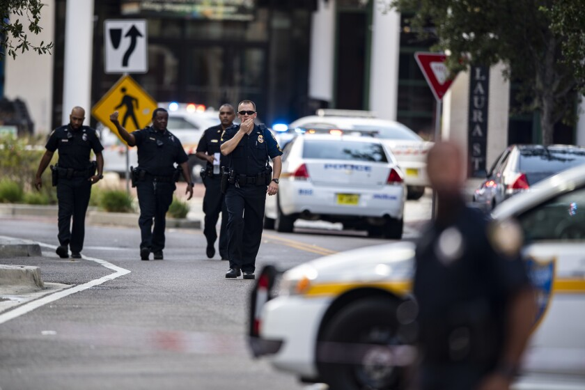 Police gather after an active shooter was reported at the Jacksonville Landing in Jacksonville, Fla.