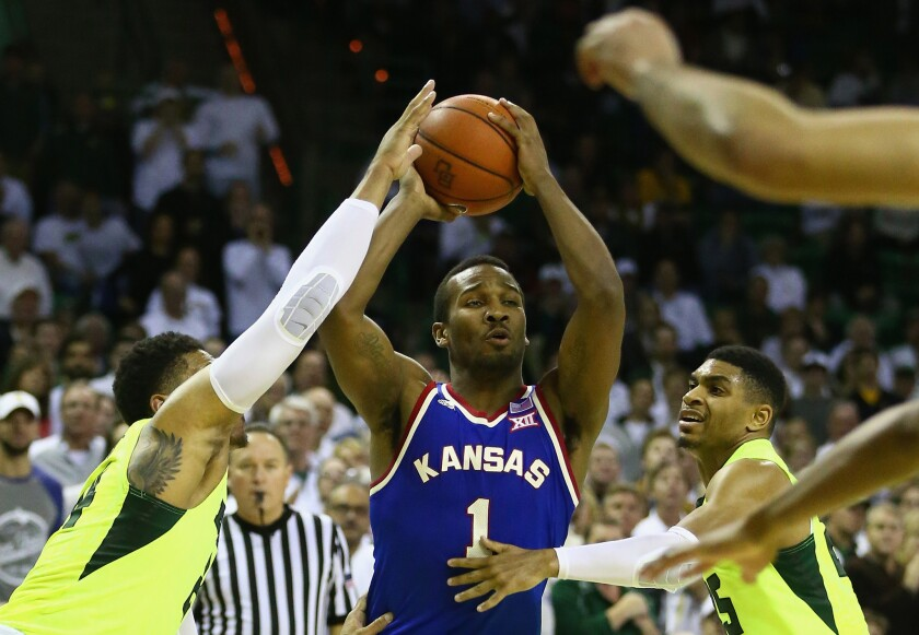 No. 2 Kansas holds off No. 19 Baylor, 66-60, for eighth victory in a row