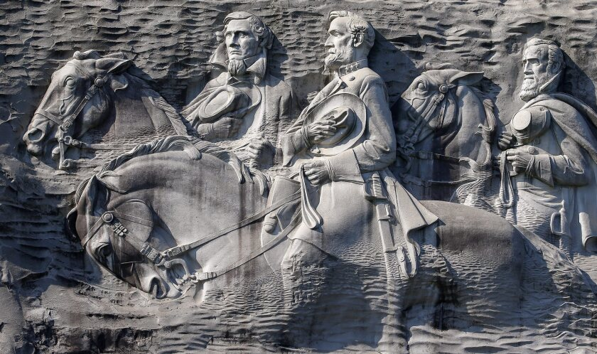 "Confederate leaders Jefferson Davis, left, Robert E. Lee and Thomas J. ""Stonewall"" Jackson are depicted on Stone Mountain."