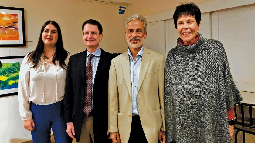La Jolla Community Center director Nancy Walters (left) and board president Ruth Yansick (right) welcome Dr. Scott Lippman and Dr. Wael Al-Delaimy, Nov. 10, 2019 as Distinguished Speakers reporting to the community on cancer research findings.