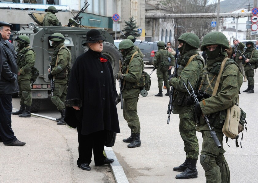 Troops block a base of the Ukrainian frontier guard unit in the Crimean town of Balaklava, Ukraine. Russian forces have been sent to the Crimean region, which is strongly opposed to the transitional pro-Western government in the Ukrainian capital, Kiev.
