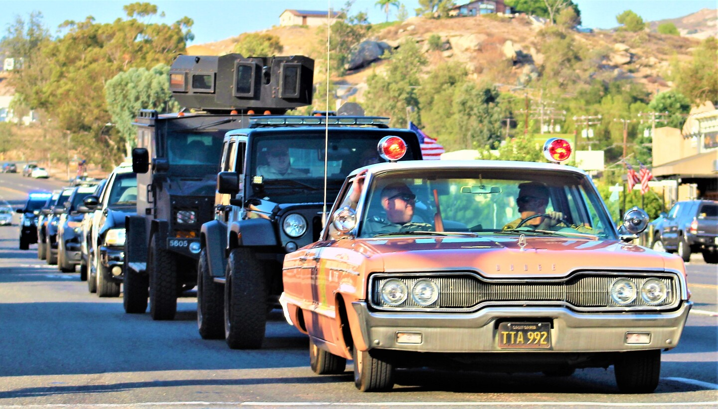 Vintage and modern vehicles are lined up along Main Street for the American Graffiti Cruise night honoring first responders.