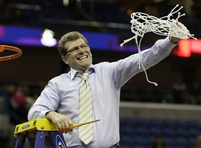 Connecticut head coach Geno Auriemma reacts after cutting the net down with Connecticut players celebrating after defeating Louisville 93-60 in the national championship game of the women's Final Four of the NCAA college basketball tournament, Tuesday, April 9, 2013, in New Orleans.  (AP Photo/Dave