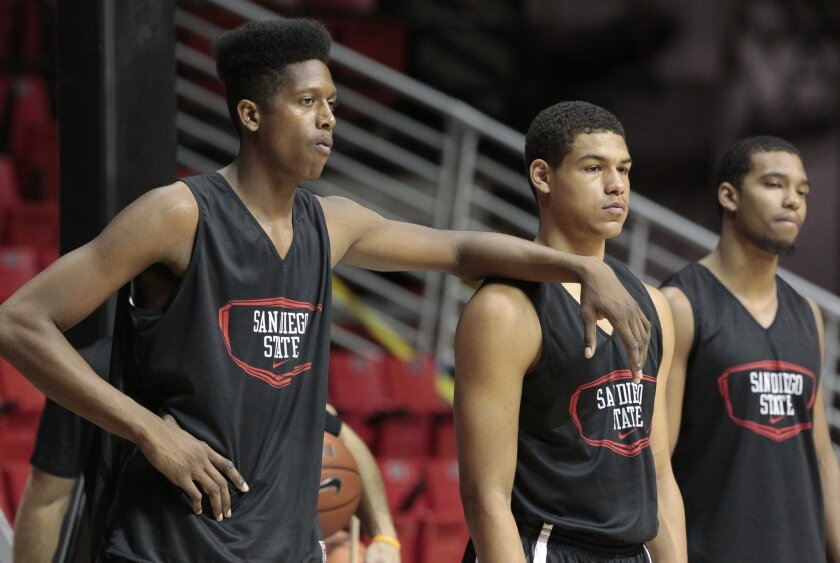 The Aztecs' Malik Pope puts his arm on the shoulder of Trey Kell during practice at the Viejas Arena at SDSU in San Diego on Friday.
