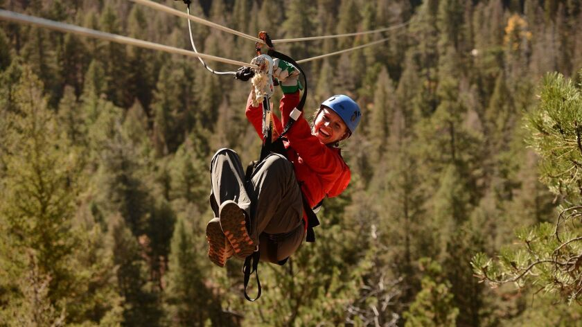 Soaring Adventures course with 10 ziplines, two bridges, and a rappel into Seven Falls. Courtesy of
