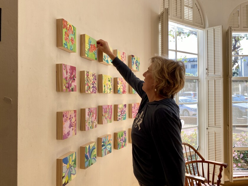Artist Prudence Horne arranges her works in the Athenaeum Music & Arts Library's rotunda in La Jolla before the exhibition is canceled due to coronavirus concerns.