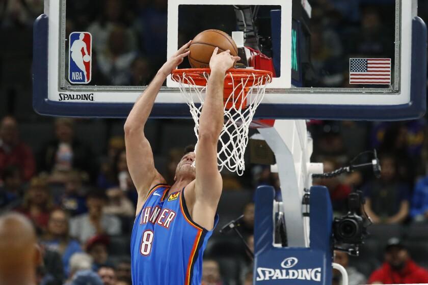 Oklahoma City Thunder forward Danilo Gallinari dunks during the first half of the team's NBA basketball game against the Minnesota Timberwolves on Friday, Dec. 6, 2019, in Oklahoma City. (AP Photo/Sue Ogrocki)