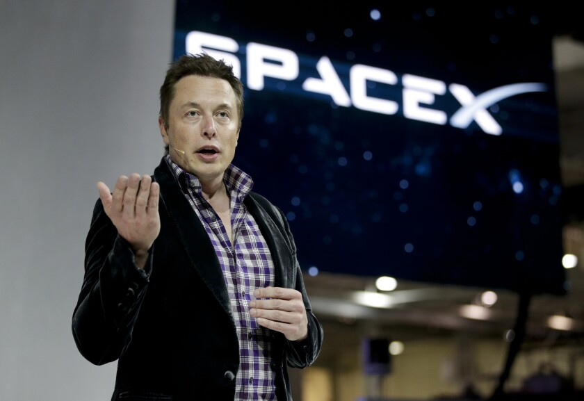 SpaceX CEO Elon Musk introduces the Dragon V2 spaceship at the company's headquarters in Hawthorne.