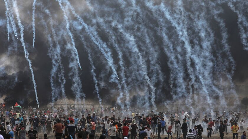 Clashes between Palestinian protestors and Israeli solders near border fence continue, Eastern Gaza City, --- - 04 May 2018
