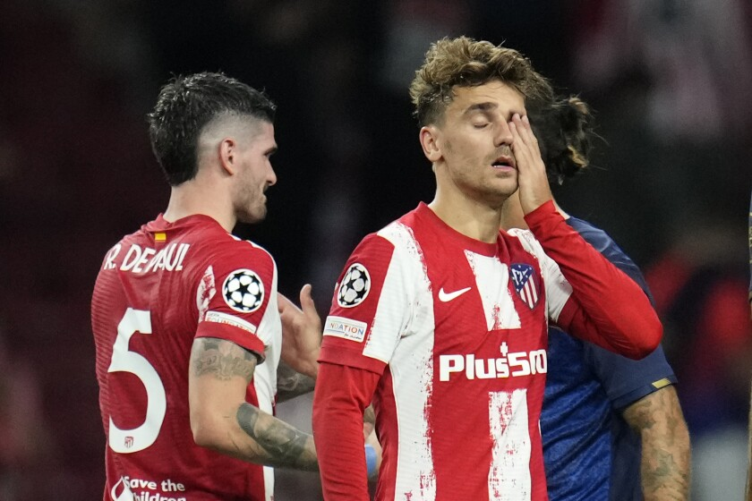 Atletico Madrid's Antoine Griezmann wipes his eyes at the and of the Champions League Group B soccer match between Atletico Madrid and Porto at Wanda Metropolitano stadium in Madrid, Spain, Wednesday, Sept. 15, 2021. (AP Photo/Manu Fernandez)