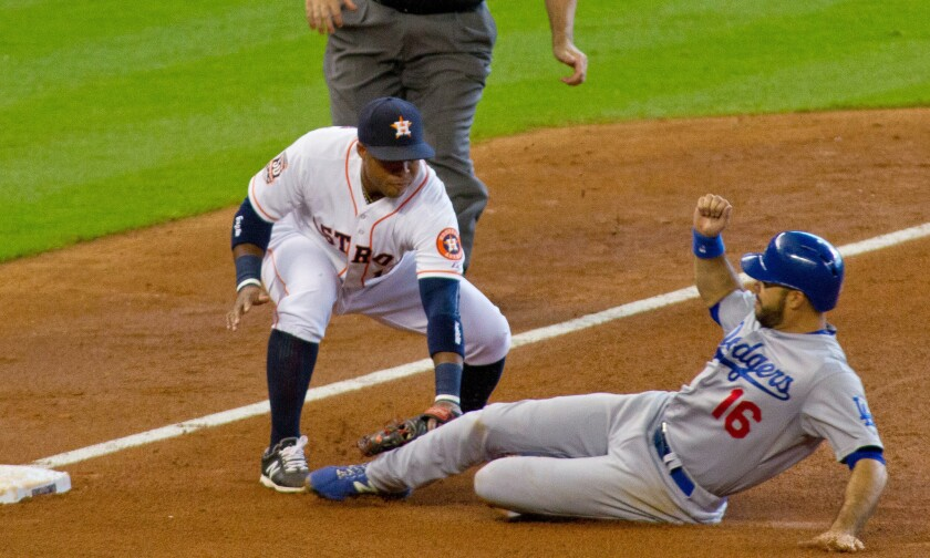 Outfielder Andre Ethier, seen here caught stealing against the Astros, and the Dodgers hope to be able to break out of their offensive funk.