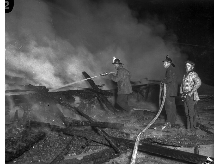 May 31, 1924: Firemen at the scene of the fire at the Hope Development School for mentally disabled