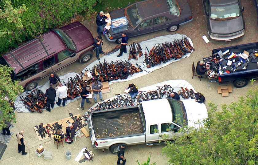 Authorities seized more than a thousand guns from a Holmby Hills home after getting an anonymous tip regarding illegal firearms sales in a posh area near the Playboy Mansion. They served a search warrant around 4 a.m. Wednesday.
