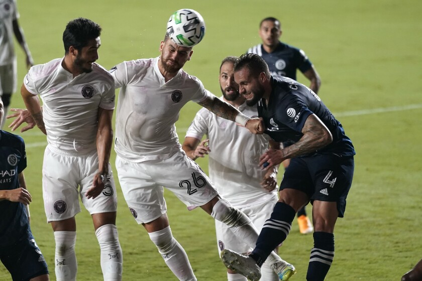Inter Miami defender Leandro Gonzales Pirez (26) attempts a shot on the goal as New York City FC defender Maxime Chanot (4) defends during the first half of an MLS soccer match, Saturday, Oct. 3, 2020, in Fort Lauderdale, Fla. (AP Photo/Lynne Sladky)