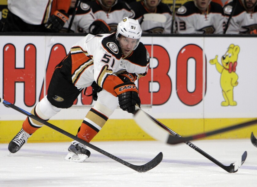 Ducks forward Dany Heatley snags the puck away from the Kings during a game Sept. 24 at Staples Center. The Ducks waived Heatley on Monday.