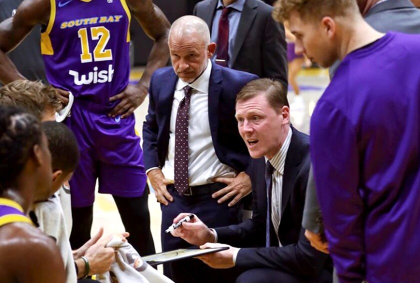 South Bay Lakers coach Coby Karl draw up a play during a recent G League game.
