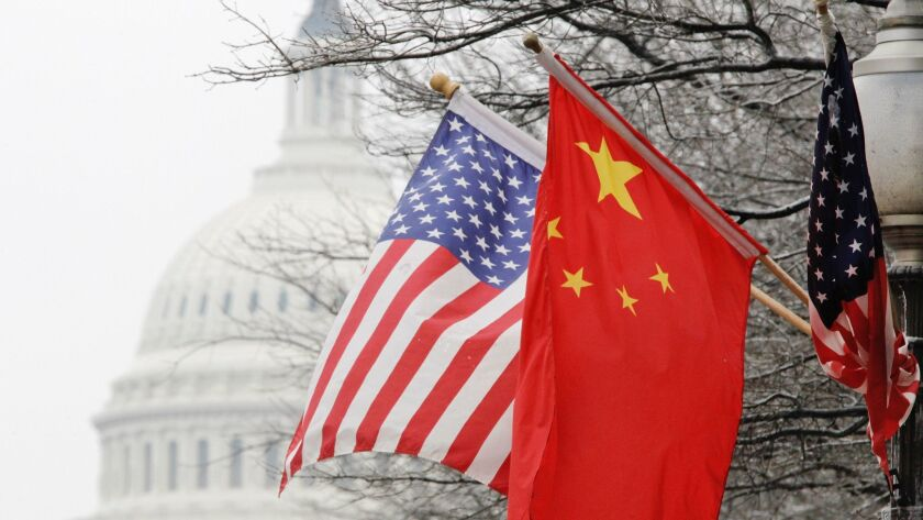 U.S. and Chinese flags fly near the Capitol in Washington in 2011.
