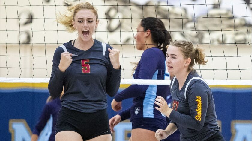 Ocean View's Helen Reynolds, left, celebrates after winning a point during a match against Marina on