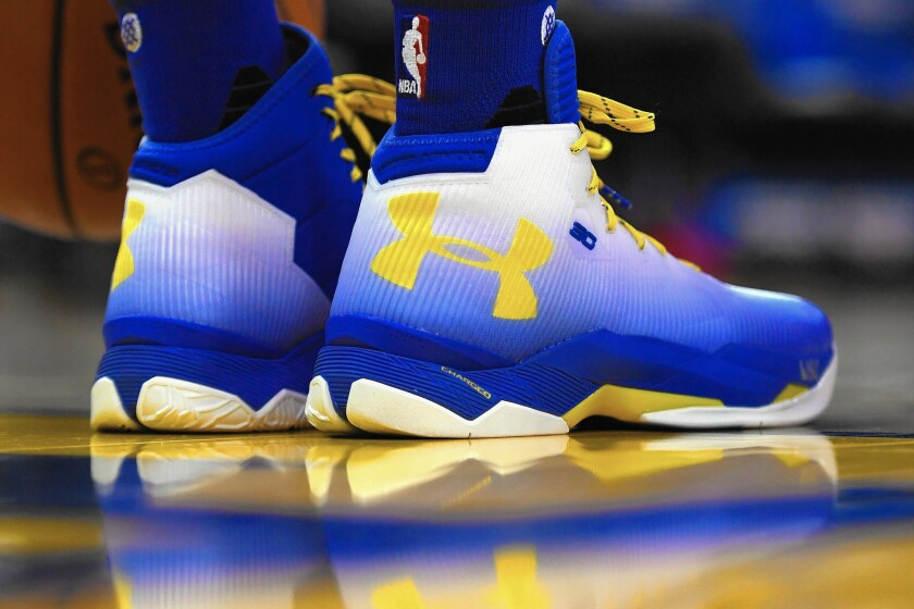 Stephen Curry of the Golden State Warriers wears Under Armour sneakers during a game April 13.
