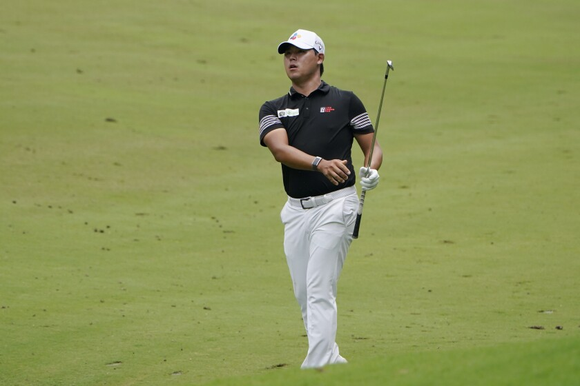 Si Woo Kim watches his shot on the 17th hole at the Wyndham Championship on Aug. 15, 2020, in Greensboro, N.C.