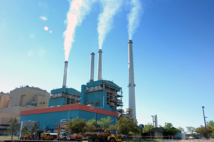 Obama must walk a climate tightrope