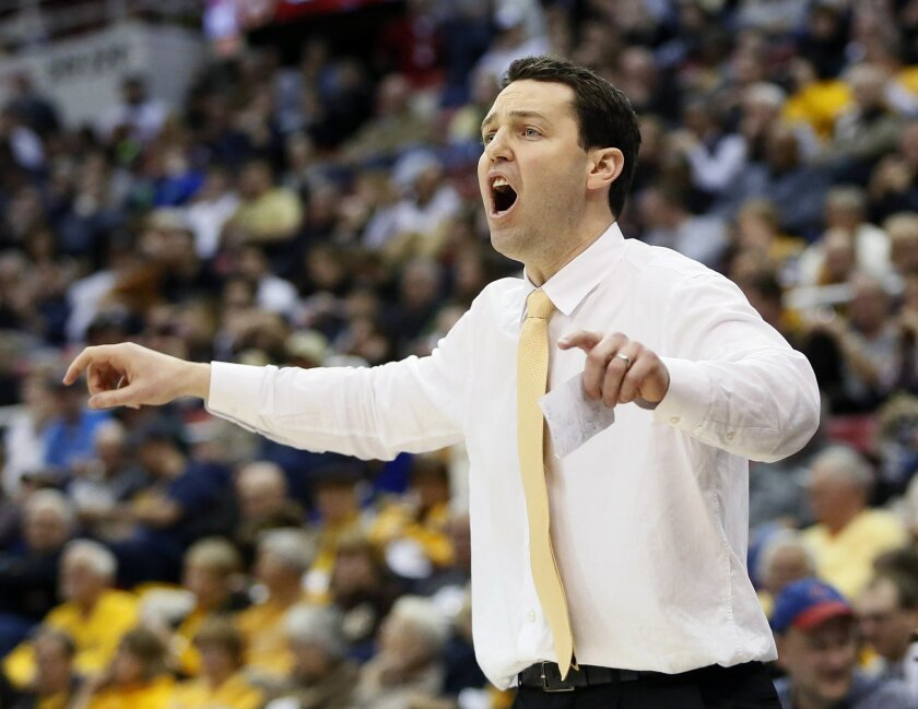 FILE - In this March 7, 2016, file photo, Valparaiso head coach Bryce Drew shouts instructions to his team during an NCAA college basketball game against Green Bay in the Horizon League tournament in Detroit. Vanderbilt has lured Bryce Drew away from his alma mater at Valparaiso to coach the Commod