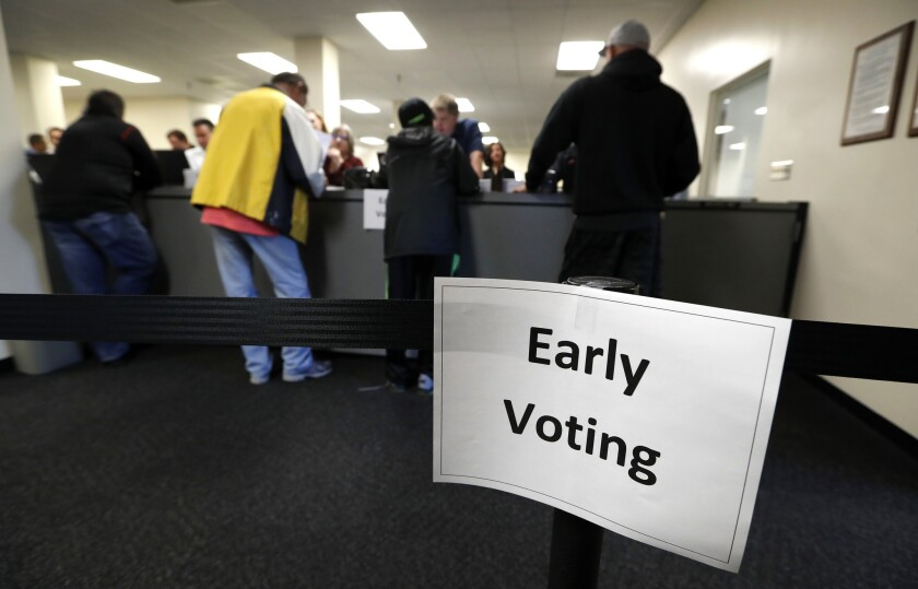 Residents receive their ballots at the Polk County Election Office on the first day of early voting in Des Moines, Iowa.