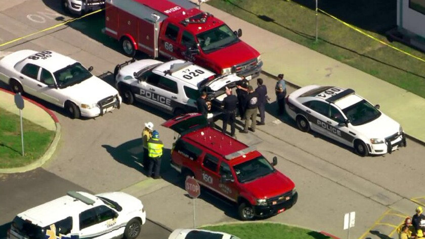 Police and paramedics respond to Christa McAuliffe Elementary School in Oxnard after a student was struck by a stray bullet Thursday.