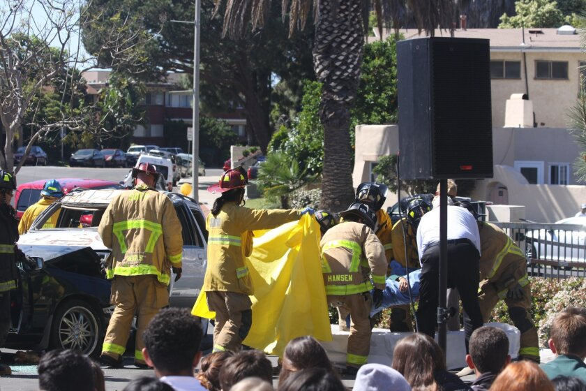Fire & Rescue personnel remove Ariana's 'deceased' body after the accident.